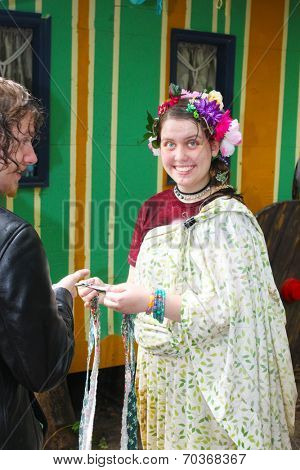 MUSKOGEE, OK - MAY 24: A woman in Gypsy village talks to a man at the Oklahoma 19th annual Renaissance Festival on May 24, 2014 at the Castle of Muskogee in Muskogee, OK