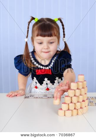 Little Girl Playing With Toys On Table