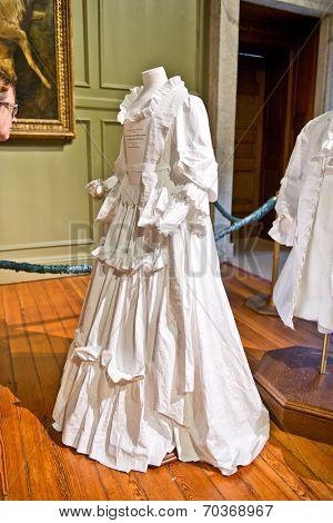 HAMPTON COURT, UK - AUGUST 03, 2014 - White baroque style female dress at Hampton Court Palace near London