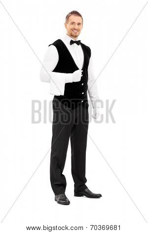 Full length portrait of a professional waiter with a towel around his arm isolated on white background