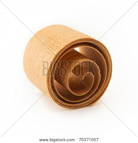 Beautifully rolled wood shaving isolated on white.