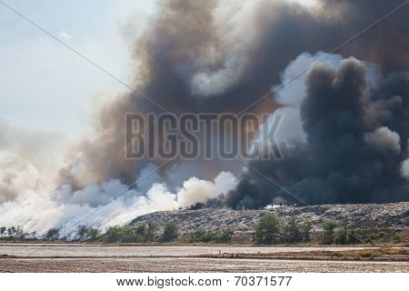 Burning Garbage Heap Of Smoke