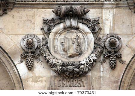 PARIS, FRANCE - NOVEMBER 08, 2012: Architectural details of Opera National de Paris: Cimarosa Facade sculpture. Grand Opera is famous neo-baroque building in Paris, France. UNESCO World Heritage Site.