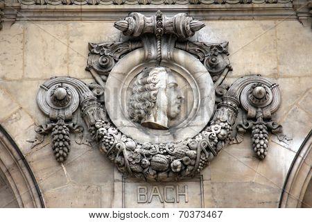 PARIS, FRANCE - NOVEMBER 08, 2012: Architectural details of Opera National de Paris: Bach Facade sculpture. Grand Opera is famous neo-baroque building in Paris, France - UNESCO World Heritage Site.