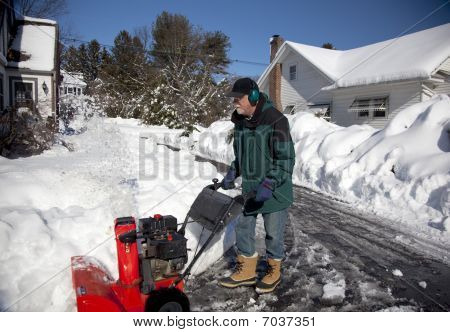 Middle-aged Man Pushing Snowblower