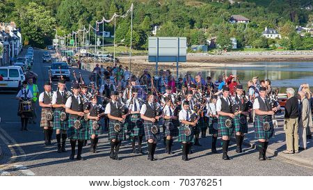 Ullapool, Scotland - July 17: Bagpipes' Parade At Local Highland Games On July 17, 2014 In Ullapool,