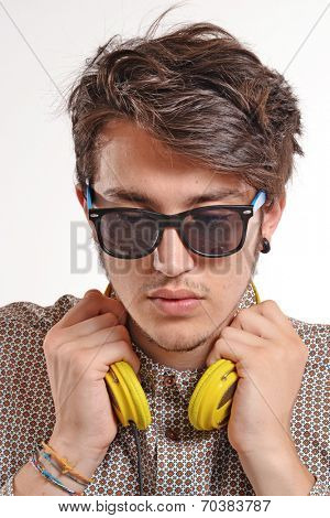 Young man wearing yellow headphones.The deejay portrait.