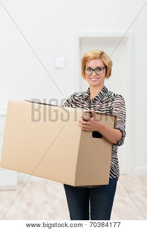 Pretty Woman In Glasses Carrying A Cardboard Box