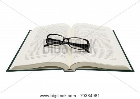 Folded Eyeglasses On Opened Book