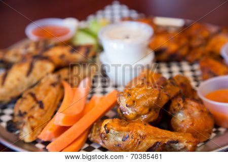Chicken Wings With Sauce At A Restaurant