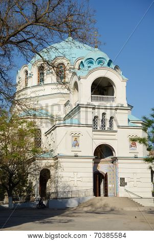 EUPATORIA, CRIMEA, UKRAINE - MAY 6, 2013: Disabled man under the church of St. Nicholas. Opened in 1899, it's the second largest church in Crimea after the church of St. Vladimir in Khersones