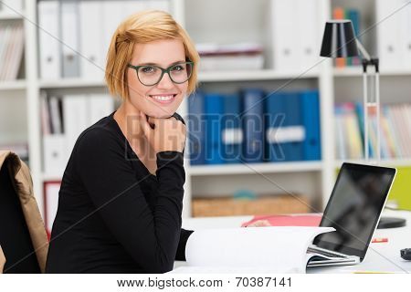 Smiling Young Businesswoman Doing Paperwork