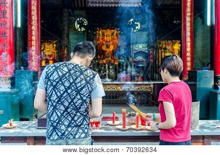 People praying at Thien Hau Pagoda