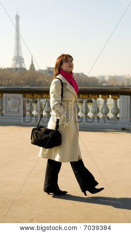 Beautiful Woman In Paris Walking On The Pont Alexandre Iii