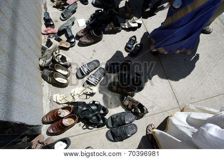NEW YORK - AUGUST 30: Hindus leave their shoes outside the Sri Ganesa Chaturthi prior to praying in celebration of the birth of Ganesh on August 30, 2003 in Flushing, New York.