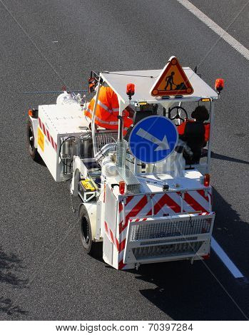 PILSEN CZECH REPUBLIC - AUGUST 19, 2014: Unidentified workers driving maintenance vehicle. Painting new road signs on highway D5 Praha - Rozvadov.