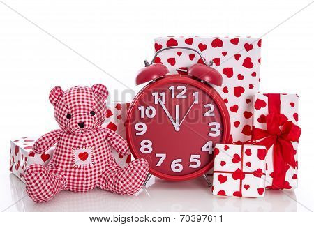 Red And White Presents With Clock And  Pink Teddy Bear On White Background - Last Minute