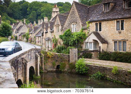WILTSHIRE, CHIPPENHAM, UK - AUGUST 9, 2014: Bridge in Castle Combe village