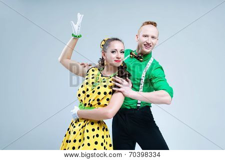 Portrait lovely funny dancer couple dressed in boogie-woogie rock n roll pin up style