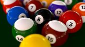 pic of pool ball  - A set of racked pool balls on a table with selective focus on the 8 ball in the center - JPG