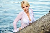 picture of wet pants  - A beautiful girl in sea water she is wearing white pants white bra and white shirt - JPG
