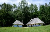 picture of farmworker  - Traditional old rural Ukrainian wattle and daub houses in Pirogovo park - JPG