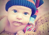 picture of knitted cap  - cute happy newborn baby in knitted hat cap - JPG