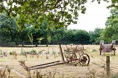 image of household farm  - peasant household with abandoned farm equipment in village de Breca Briere Regional Natural Park France - JPG