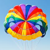 stock photo of parasailing  - canopy of parachute for parasailing in blue sky - JPG