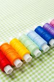 stock photo of view from space needle  - row of thread spools in rainbow colors  collection top view - JPG