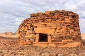 pic of empty tomb  - Ancient Nabatean tombs at sunset in the remote desert - JPG
