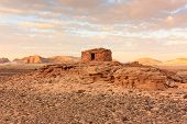 picture of empty tomb  - Ancient Nabatean tombs at sunset in the remote desert - JPG