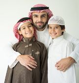 stock photo of muslim kids  - Arabic young father posing with kids - JPG