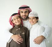 image of muslim kids  - Arabic young father posing with kids - JPG