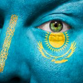 picture of mongol  - Flag painted on face with green eye to show Kazakhstan support - JPG