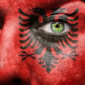 foto of albania  - Flag painted on face with green eye to show Albania support - JPG