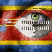 foto of coexist  - Flag painted on face with green eye to show Swaziland support - JPG
