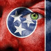 image of memphis tennessee  - Flag painted on face with green eye to show Tennessee support - JPG