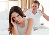 stock photo of bereavement  - Pessimistic couple having an argument in the bedroom - JPG