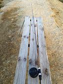 image of fly rod  - Fly fishing rod on a frost covered bench in winter - JPG
