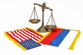 picture of cold-war  - American and Russian flag with decorative scales of justice on white background - JPG