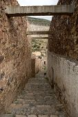foto of descending  - narrow descending stone street in Real de CAtorce Mexico - JPG