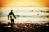 foto of board-walk  - Surfer on the beach at sunset - JPG