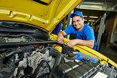 pic of assemblage  - auto repairman mechanic portrait in car auto repair or maintenance shop service station - JPG