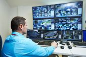 foto of cctv  - security guard watching video monitoring surveillance security system - JPG