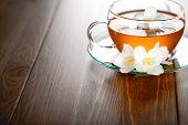pic of jasmine  - Jasmine tea with jasmine herb flower on wooden background - JPG