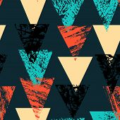 stock photo of harlequin  - Grunge hand painted bold pattern with textured triangles in bright multiple colors - JPG