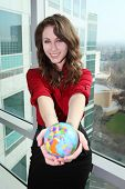 Pretty Woman Holding Globe
