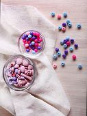 picture of crown green bowls  - Different beads in glass bowls on fabric on table - JPG