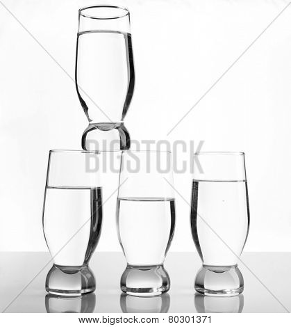 Glasses of water on light background